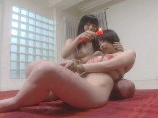 Mayura and Kasumi drip candle paraffin wax while bound